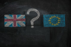 Brexit, flags of the United Kingdom and the European Union with question mark between  on blackboard. Brexit, flags of the United Kingdom and the European Union Stock Photos