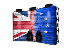 Brexit, Flags Of The United Kingdom And The European Union On Wooden Background With Shoes - Business Concept On Banner Display. With Lights royalty free stock images