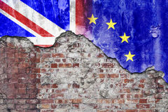 Brexit Grungy Wall. Grungy wall with painted UK and European Union flags flaking off Stock Image