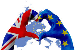 Brexit, hands of man in heart shape patterned with the flag of blue european union EU and flag of great britain uk on europe map stock photography