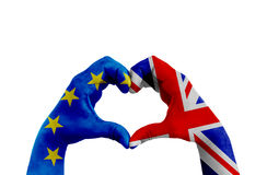 Brexit, hands of man in heart shape patterned with the flag of blue european union EU and flag of great britain uk on the white ba Stock Photo