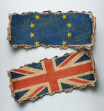 Brexit illustration. European union and Great Britain flags on cardboard. Royalty Free Stock Photo