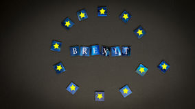 Brexit. Mosaic pieces in front of black background - BREXIT Stock Photos