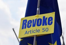 Brexit pro revoke article 50 protest sign in Westminster London. March 28 2019. An anti leave the EU, pro remain protest sign that reads `Revoke Article 50` in royalty free stock photo