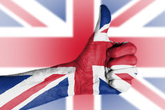 Brexit result - Thumbs up in front of Union Jack. Flag Stock Photography