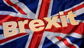 Brexit słowo na Wielkiej Brytania flaga tkaninie Obrazy Stock