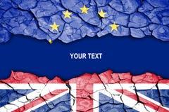 Brexit spricka mellan flaggor av UK och EU Arkivfoto
