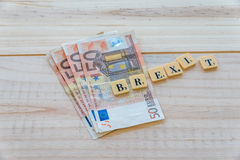 Brexit text with euro money Stock Images
