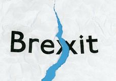 Brexit on torn paper. Torn paper with word Brexit representing the growing request to revoke Article 50 to stop Brexit and remain in the EU, after the ECJ stock photo