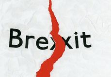 Brexit on torn paper. Torn paper with word Brexit representing the growing request to revoke Article 50 to stop Brexit and remain in the EU, after the ECJ stock photography