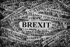 Brexit. Torn pieces of paper with the word . Concept Image. Black and White. Closeup royalty free stock photos