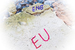Brexit UK EU referendum concept with word UN and Eng on stone wall Royalty Free Stock Photos