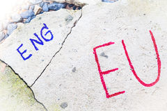 Brexit UK EU referendum concept with word UN and Eng on stone wall Royalty Free Stock Photo