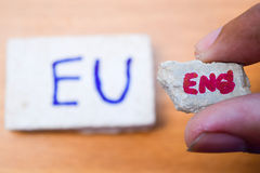 Brexit UK EU referendum concept with word UN and Eng on stone wall. Background royalty free stock photo