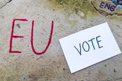 Brexit UK EU referendum concept with word UN and Eng and vote on stone wall Stock Image