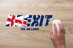 Brexit UK EU referndum with mouse on wooden background Royalty Free Stock Photo