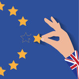 Brexit UK hand removing star from EU flag leaving just stitches behind. Stock Image