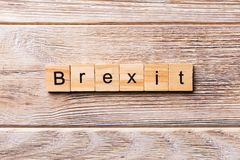 Brexit word written on wood block. Brexit text on wooden table for your desing, concept royalty free stock image