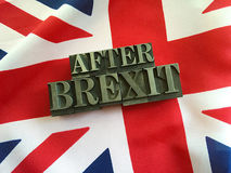 After Brexit words on UK flag. British flag with the words after Brexit in metal type letters Royalty Free Stock Photography