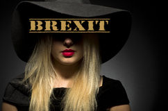 Brexit written on black hat. Woman in black big hat Royalty Free Stock Image