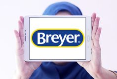 Breyer manufacturer logo. Logo of Breyer manufacturer on samsung tablet holded by arab muslim woman. Breyer  is a manufacturer of model animals. The company Royalty Free Stock Photos