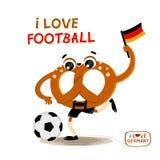 Brezel de bretzel avec du ballon de football et le drapeau de l'Allemagne Photo libre de droits