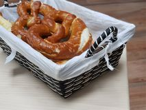 Brezel. Pretzels are baked from wheat, barley or rye flour. The dough is rolled out to a long narrow sausage and given the form of an eight or a ring. A classic Stock Photo