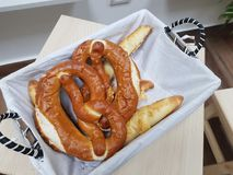 Brezel. Pretzels are baked from wheat, barley or rye flour. The dough is rolled out to a long narrow sausage and given the form of an eight or a ring. A classic Royalty Free Stock Photography