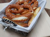 Brezel. Pretzels are baked from wheat, barley or rye flour. The dough is rolled out to a long narrow sausage and given the form of an eight or a ring. A classic Royalty Free Stock Image