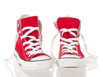 brezentowych czerwonych sneakers odwiązany rocznik Zdjęcia Royalty Free