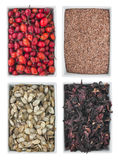 Briar, flax seed, pumpkin seed, hibiscus, in a of ceramic plate Stock Photos
