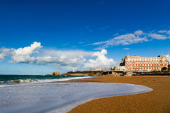 Briarritz Great Beach. The Grande Plage form Biarritz under a partialy cloudy blue sky. Famous Hotel du Palais in the background Stock Image