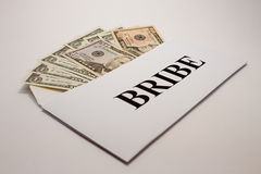 Bribe. Dollars in an envelope with an inscription Bribe stock images