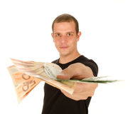 Bribe. Young man with euro banknotes Royalty Free Stock Photography