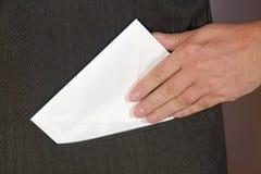 Bribe. White envelope in hip pocket Royalty Free Stock Image