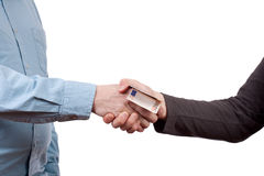 Bribe. Man giving money to another man as a bribe stock photo