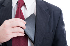 Bribe or bribery concept with wallet from inside suit jacket Royalty Free Stock Photography