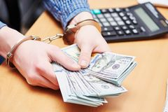 Bribe concept. dollars and handcuffs Stock Photos