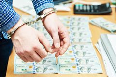 Bribe concept. dollars and handcuffs Royalty Free Stock Photo