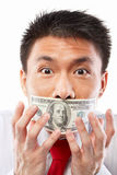 Bribe concept, mouth sealed with dollar bill Stock Image