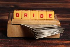 Bribe. Concept shot of bribe with beautiful background stock photography