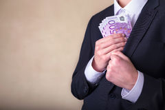 Bribe and corruption with euro banknotes. Man in Men's Suits.Bribe and corruption with euro banknotes Royalty Free Stock Images