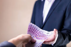 Bribe and corruption with euro banknotes. Royalty Free Stock Images