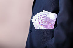 Bribe and corruption with euro banknotes. Royalty Free Stock Photography