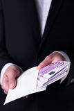 Bribe and corruption with euro banknotes. Royalty Free Stock Photos