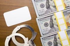 Bribe dollar near the handcuffs Royalty Free Stock Photo