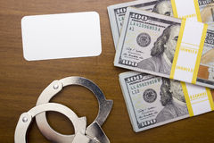 Bribe dollar near the handcuffs Royalty Free Stock Image