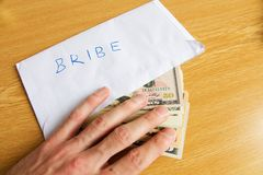Bribe in dollars Stock Photo