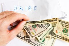 Bribe in dollars Royalty Free Stock Images