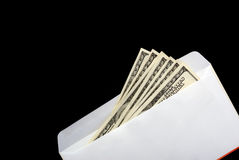 Bribe in an envelope black background Royalty Free Stock Image